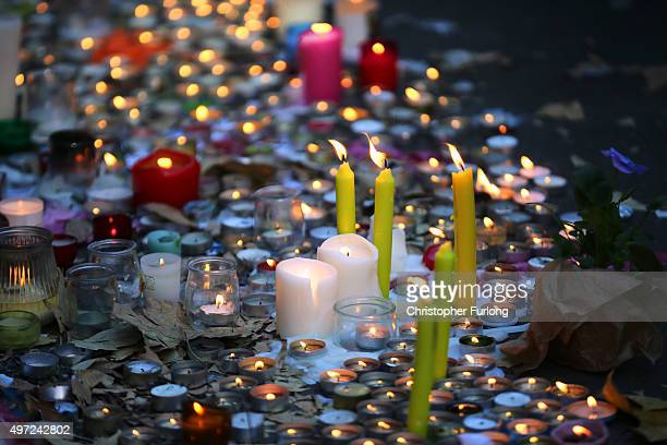 Candles are lit outside La Belle Equipe restaurant on Rue de Charonne following Fridays terrorist attack and France observes three days of national...