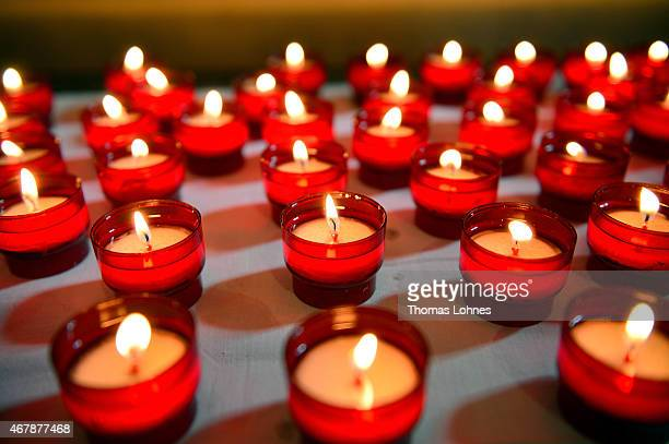 Candles are lit to remember the victims of the Germanwings Airbus flight in a service at the 'Notre Dame du Bourg' cathedral on March 28 2015 in...