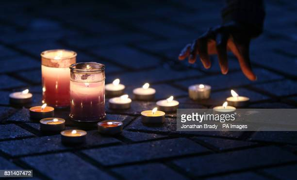 Candles are lit under the West Way road London as speakers address marchers who took part in a silent procession to pay respect to those killed in...