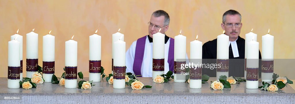 15 candles are seen during a memorial service at the Sankt Karl Barromaeus church on March 21, 2009 in Winnenden near Stuttgart, Germany. President Koehler, chancellor Merkel and thousands of mourners hold a memorial ceremony to commemorate the victims of a school shooting. 17 - year old Tim Kretschmer opened fire on Wednesday, March 11, 2009 on teachers and pupils at his former school, killing 15 people and leaving many more injured. Kretschmer fled the scene and shot himself dead after being cornered by police.