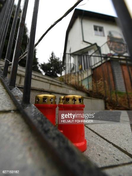 Candles are seen on December 2 2016 in front of a house where six bodies have been found yesterday in Boeheimkirchen Lower Austria The death of six...