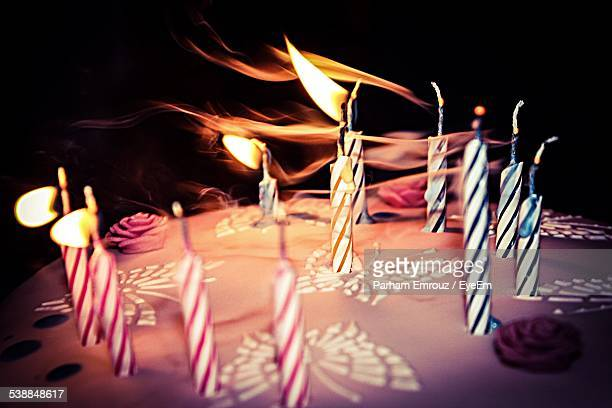 Candles Blowing Out On Cake