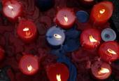 Candles burn in front of the AlbertvilleSchool Centre on March 12 2009 in Winnenden near Stuttgart Germany 17 year old Tim Kretschmer opened fire...
