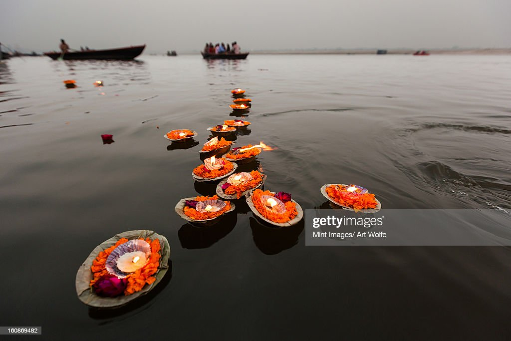 Candles floating in the Ganges River, Varanasi, India : Stock Photo
