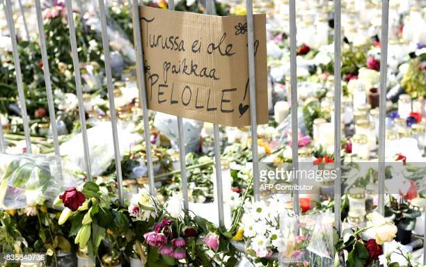 Candles flowers and a placard reading 'There is no place for fear in Turku' have been left at the makeshift memorial for the victims of Friday's...