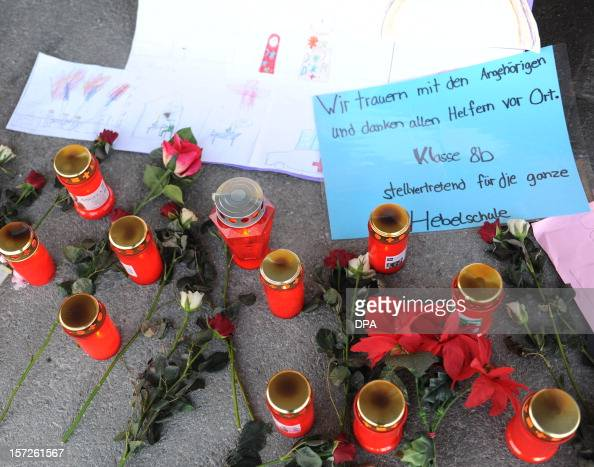 Candles flowers and messages are laid down in front of a workshop for disabled people in Titisee Neustadt southern Germany on December 1 2012 An...