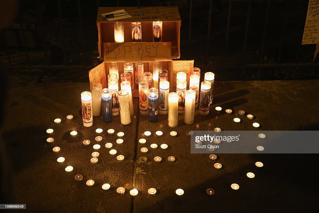 Candles form a memorial for Rey Dorantes outside his home on what would have been his 15th birthday on January 15, 2013 in Chicago, Illinois. Dorantes died after being shot 6 times while he was sitting on the front porch of the home on January 11. Dorantes' murder was the 21st homicide recorded in Chicago for 2013, a city which saw more than 500 homicides in 2012.