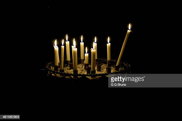 candles in a church with black background
