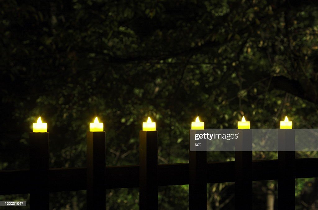 Candles in a row at night : Stock Photo