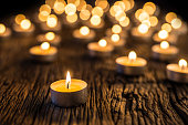 Candles light in advent.. Christmas candles burning at night. Golden light of candle flame.