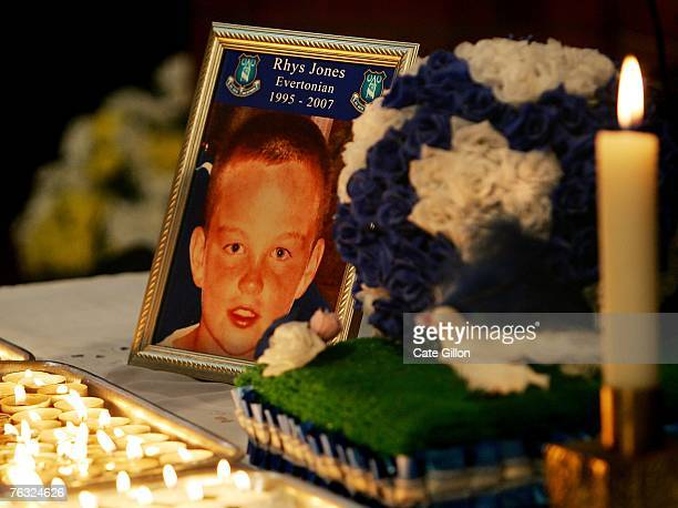 Candles lit by Everton football fans at St Luke's Church at Everton FC Football grounds burn as a mark of respect to eleven year old Rhys Jones who...