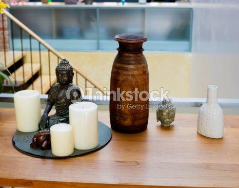 Candles next to Buddha statue : Stock Photo