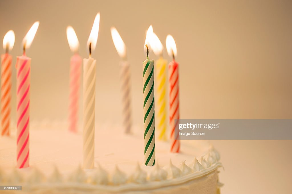 Candles on a birthday cake : Stock Photo