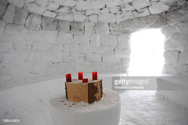 Candles on table inside igloo.