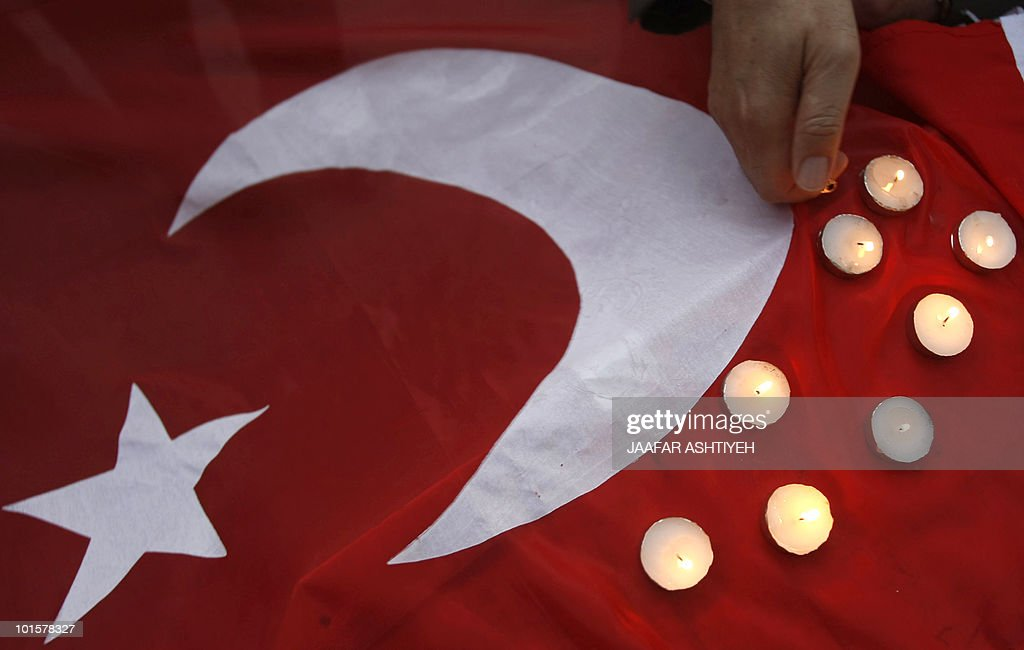 Candles placed on the Turkish flag are lit during a vigil in the Palestinian West Bank city of Nablus on June 1, 2010, the day after civilians were killed in a deadly raid by Israeli commandos on a flotilla of ships carrying humanitarian aid to the Gaza Strip.