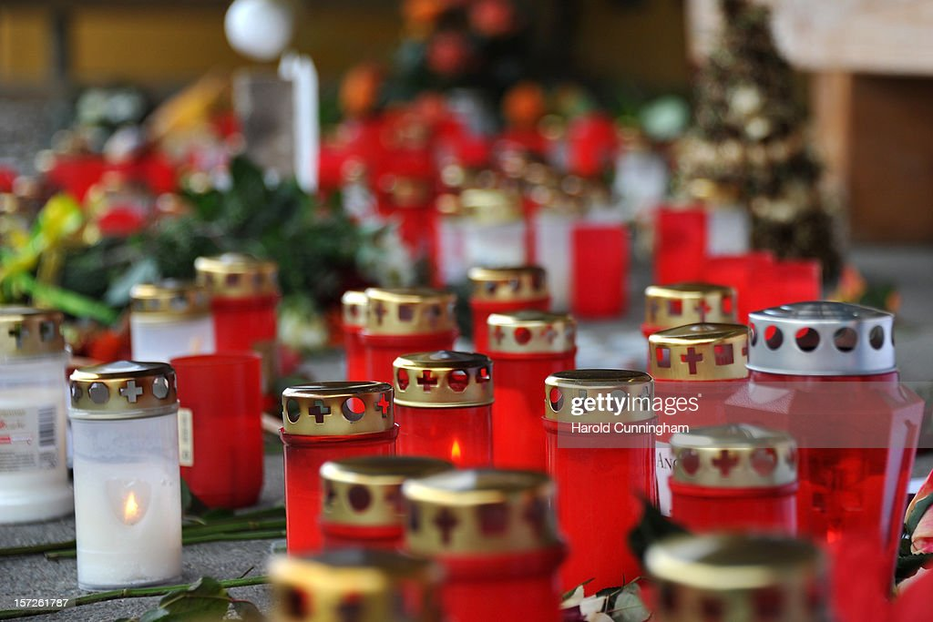 Candles rest on the ground outside the Caritas center following a deadly fire that killed 14 people at the employment facility for handicapped, on December 1, 2012 in Titisee-Neustadt, Germany. The fire was reportedly caused by an explosion at the facility, where approximately 120 people with disabilities are employed in light manufacturing.