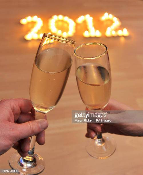 Candles spell out 2012 as people toast with champagne on New Year's Eve in Davernham