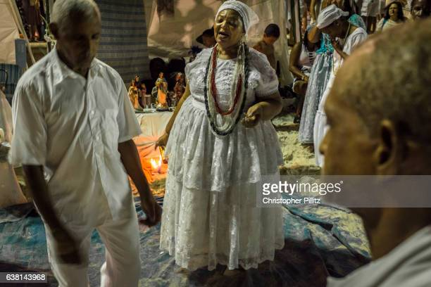 A Candomble priestess conducts a religious ceremony on Copacabana beach during the New Year celebrations.
