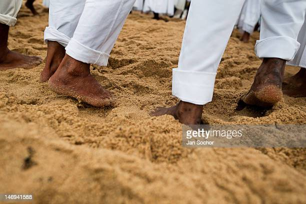 Candomble worshippers dance on the beach during the festival in honor to Yemanjá the goddess of the sea on 2 February 2012 in Salvador Bahia Brazil...