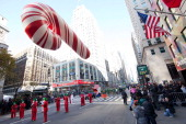 A candy cane balloon floats in Macy's Legendary Thanksgiving Day Parade on November 24 2011 in New York City