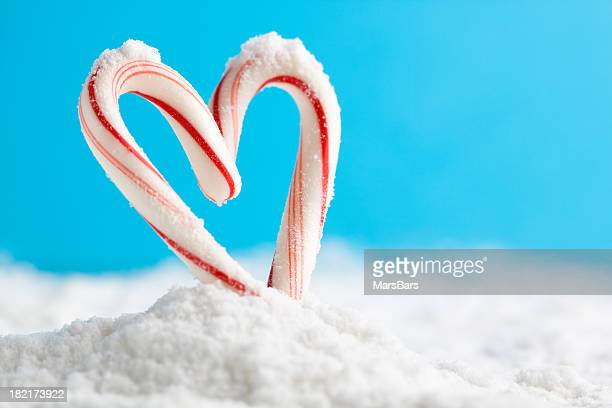 candy cane heart on snow