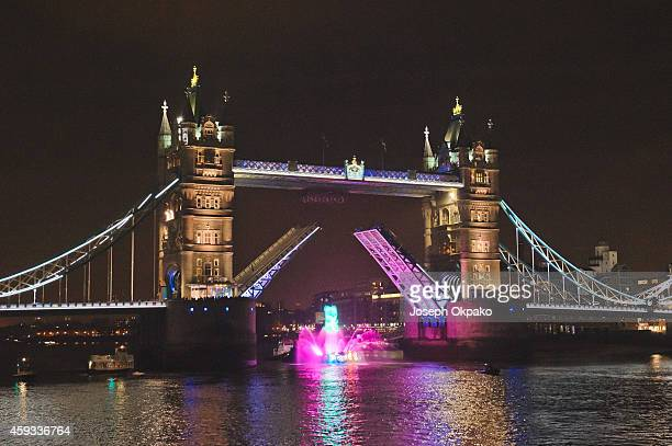 Candy Crush gummy bear cruises down the Thames underneath Tower Bridge for the Launch of Candy Crush Soda on November 20 2014 in London England
