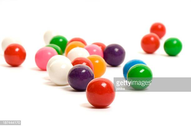 Candy gumballs from a low angle on white background