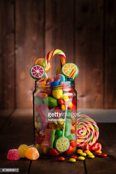 Wooden Candy Table ~ Candy jar stock photos and pictures getty images