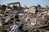 Candy Trudell looks through the wreckage of her home on IL64 after a tornado swept through the previous night on April 10 2015 in Rochelle Illinois...