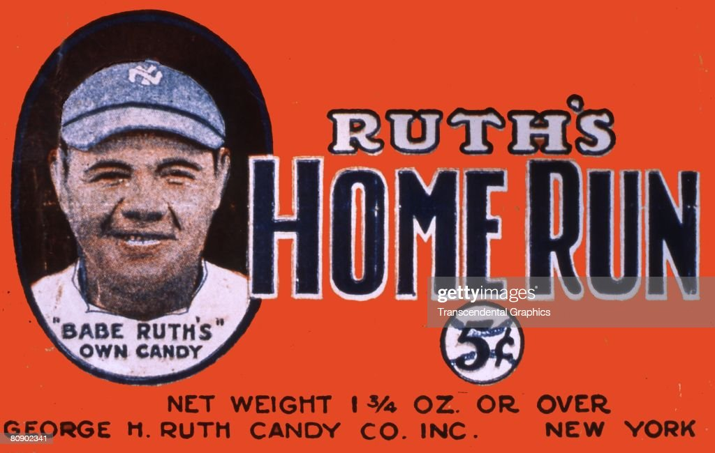 Candy wrapper for Ruth's Home Run candy bar, showing a color portrait of a smiling <a gi-track='captionPersonalityLinkClicked' href=/galleries/search?phrase=Babe+Ruth&family=editorial&specificpeople=94423 ng-click='$event.stopPropagation()'>Babe Ruth</a> with text stating '<a gi-track='captionPersonalityLinkClicked' href=/galleries/search?phrase=Babe+Ruth&family=editorial&specificpeople=94423 ng-click='$event.stopPropagation()'>Babe Ruth</a>'s Own Candy', The candy bar sold for 5 cents,
