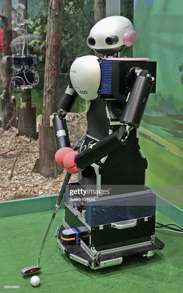 Candy05 a golf putting robot plays on the green during a demonstration at the Prototype Robot Exhibition at the 2005 World Exposition on June 9 2005...