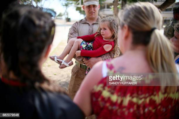 Canee Copeland is held by her Dad Cpl Cade Copeland during a homecoming reception at Camp Pendleton in Oceanside California on May 11 2017 arines and...