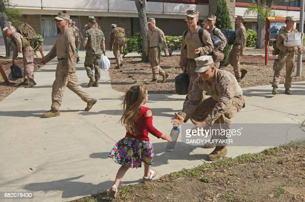 TOPSHOT Canee Copeland runs to hug her Dad Cpl Cade Copeland during a homecoming reception at Camp Pendleton in Oceanside California on May 11 2017...