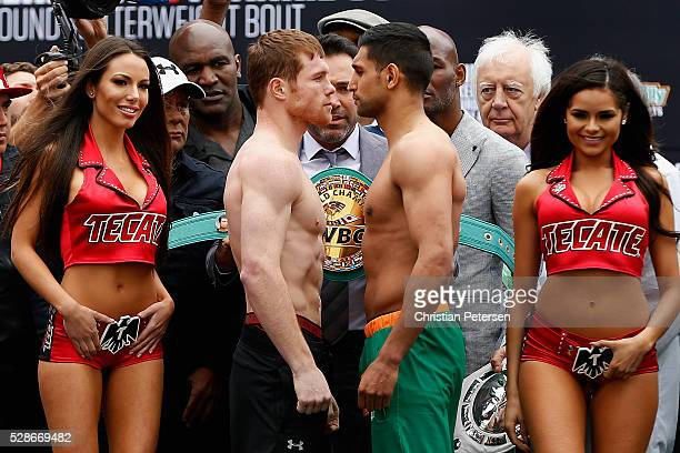 Canelo Alvarez and Amir Khan face off during their official weighin at TMobile Arena Toshiba Plaza on May 6 2016 in Las Vegas Nevada The two will...