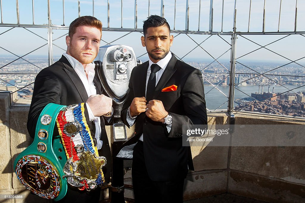 Canelo Alvarez and Amir Khan pose for photos during a press event at the Empire State Building on March 1, 2016 in New York City.