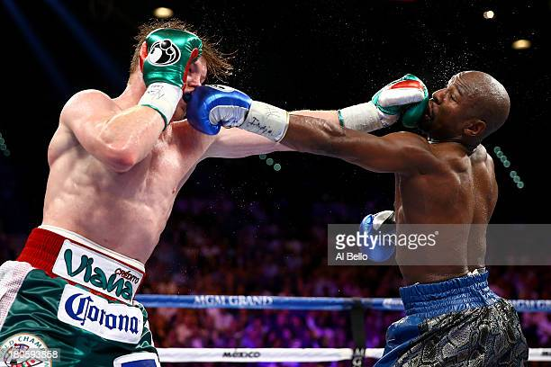 Canelo Alvarez and Floyd Mayweather Jr exchange blows during their WBC/WBA 154pound title fight at the MGM Grand Garden Arena on September 14 2013 in...