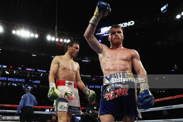 Canelo Alvarez celebrates after going twelve rounds against Julio Cesar Chavez Jr during their catchweight bout at TMobile Arena on May 6 2017 in Las...