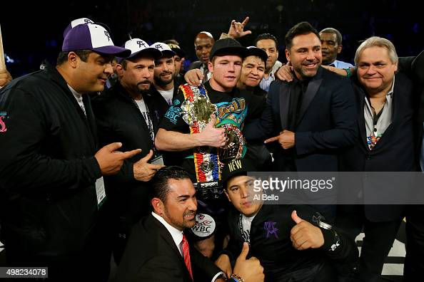 Canelo Alvarez celebrates with promoter Oscar De La Hoya after defeating Miguel Cotto by unanimous decision in their middleweight fight at the...
