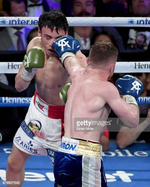 Canelo Alvarez hits Julio Cesar Chavez Jr with a left in the sixth round of their catchweight bout on May 6 2017 in Las Vegas Nevada Alvarez won by...