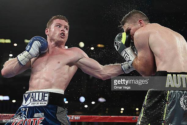 Canelo Alvarez left fights with Liam Smith right during the Canelo v Smith WBO Middleweight World Championship Fight at ATT Stadium on September 17...