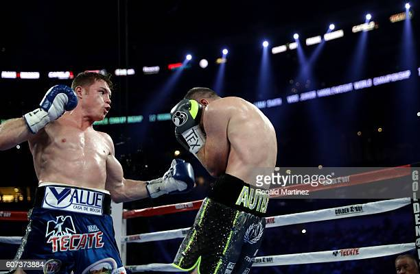 Canelo Alvarez left fights with Liam Smith right during the WBO Junior Middleweight World fight at ATT Stadium on September 17 2016 in Arlington Texas