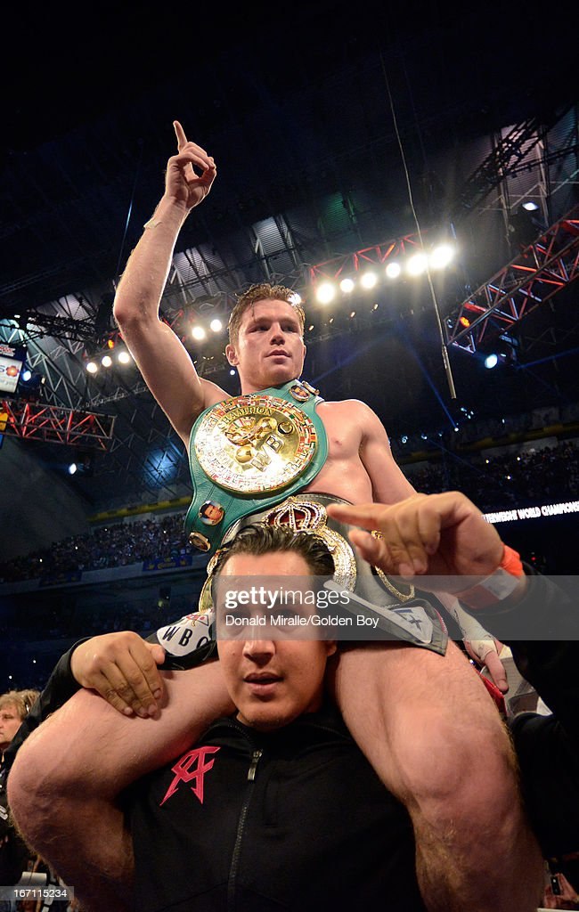Canelo Alvarez of Mexico celebrates his unanimous 12-round decision over Austin Trout of USA during the WBC, WBA, and Vacant Ring Magazine Super Welterweight Title at Alamodome on April 20, 2013 in San Antonio, Texas.