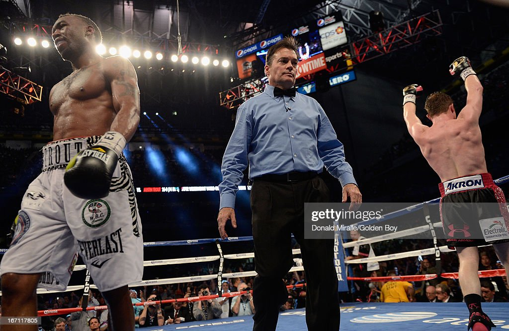 Canelo Alvarez (R) of Mexico celebrates his unanimous 12-round decision over Austin Trout during the WBC, WBA, and Vacant Ring Magazine Super Welterweight Title at Alamodome on April 20, 2013 in San Antonio, Texas.