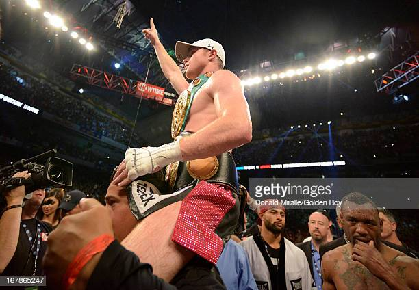 Canelo Alvarez of Mexico celebrates his win over Austin Trout during the WBC WBA and Vacant Ring Magazine Super Welterweight Title at Alamodome on...