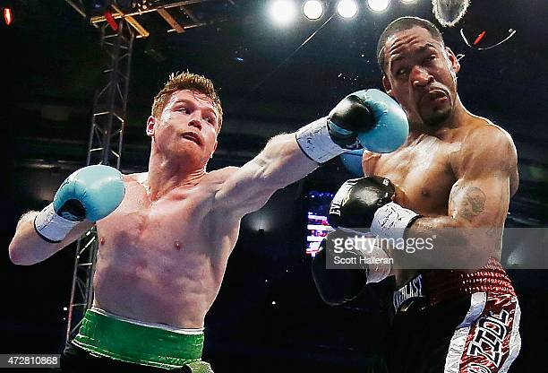 Canelo Alvarez of Mexico delivers a punch to James Kirkland during their super welterweight bout at Minute Maid Park on May 9 2015 in Houston Texas
