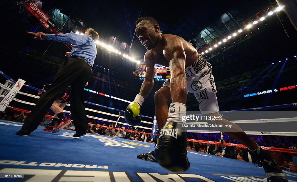 Canelo Alvarez (hidden behind referee) of Mexico knocks down Austin Trout of USA en route to Alvarez's unanimous 12-round decision during th WBC, WBA, and Vacant Ring Magazine Super Welterweight Title at Alamodome on April 20, 2013 in San Antonio, Texas.