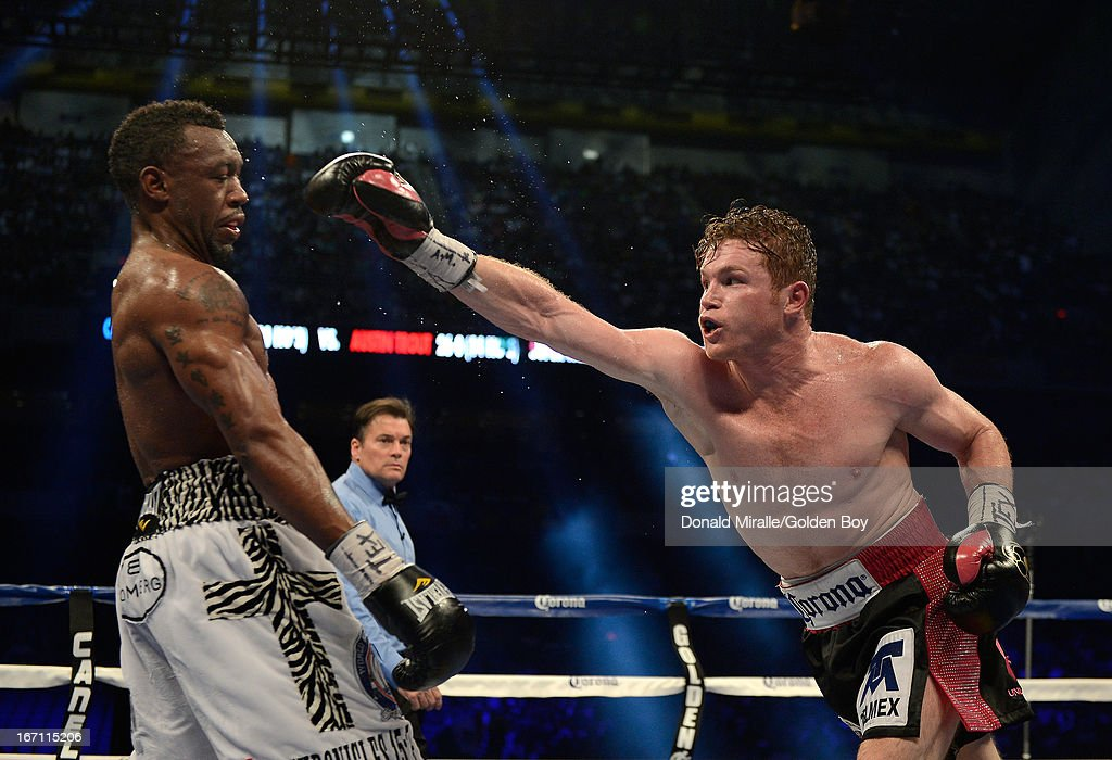 Canelo Alvarez of Mexico lands a punch on Austin Trout of USA (L) en route to Alvarez's unanimous 12-round decision during th WBC, WBA, and Vacant Ring Magazine Super Welterweight Title at Alamodome on April 20, 2013 in San Antonio, Texas.