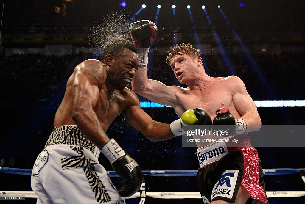 Canelo Alvarez of Mexico lands a punch on Austin Trout (L) of USA en route to Alvarez's unanimous 12-round decision during th WBC, WBA, and Vacant Ring Magazine Super Welterweight Title at Alamodome on April 20, 2013 in San Antonio, Texas.
