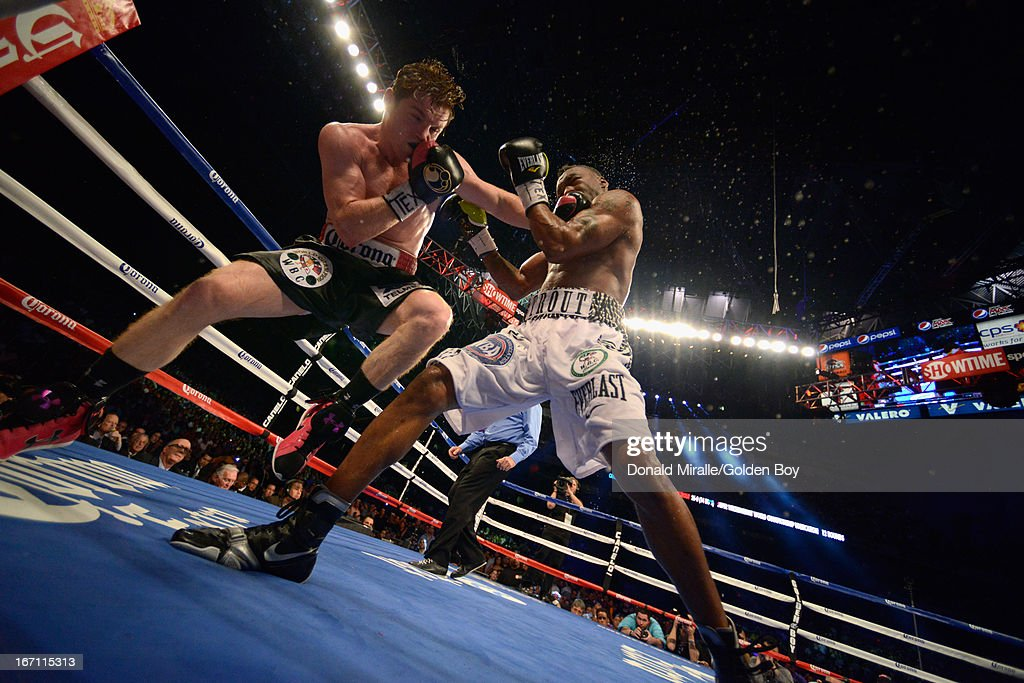 Canelo Alvarez of Mexico lands a punch on Austin Trout (R) of USA en route to Alvarez's unanimous 12-round decision during th WBC, WBA, and Vacant Ring Magazine Super Welterweight Title at Alamodome on April 20, 2013 in San Antonio, Texas.