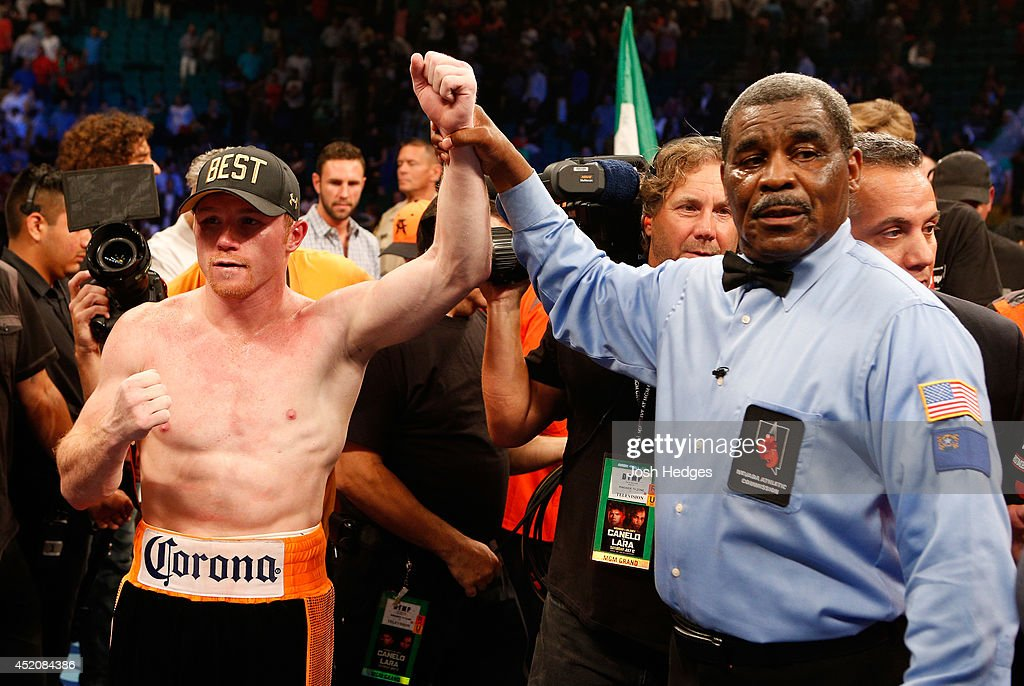 Canelo Alvarez (L) poses after his split-decision victory over Erislandy Lara during their junior middleweight bout at the MGM Grand Garden Arena on July 12, 2014 in Las Vegas, Nevada.
